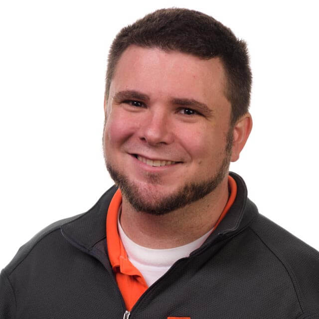 Travis Miller's professional headshot.